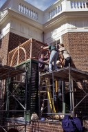 Monticello, restoration, fitting upper louver work at East Venetian porch
