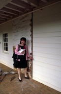 Monticello, restoration, Dependencies, Susan Stein pointing to intersection of fireplace wall and wooden partition