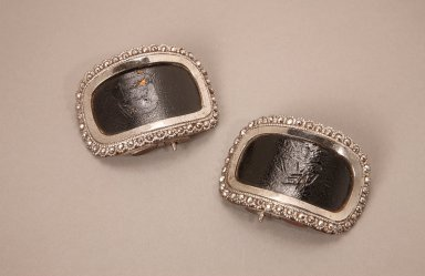 Pair of leather and steel shoe buckles