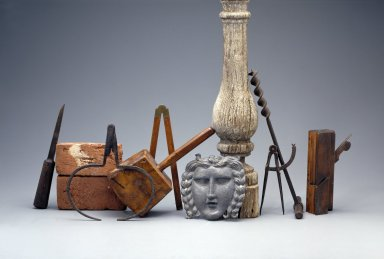 Selection of carpenter and joiner's tools displayed with architectural artifacts from Monticello.