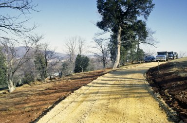 Monticello, first roundabout, laying crushed river gravel