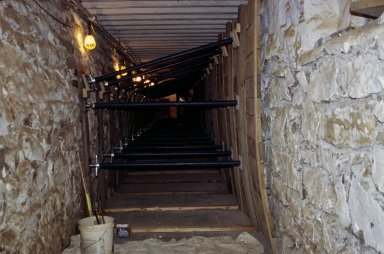 Monticello, restoration, North cellar passage, flexible wood pallets installed against west wall