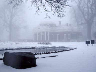 Monticello, fish pond and west elevation in snow